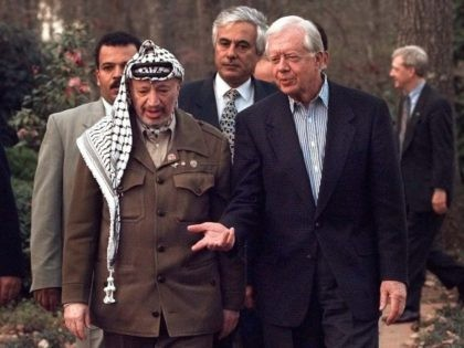 Jimmy Carter and Yasser Arafat (Ric Feld / Associated Press)