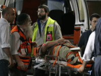 A wounded man is wheeled into a hospital in Jerusalem following a shooting attack on a religious school in the city in which at least eight students were killed on March 6, 2008. Some 35 people were wounded in the attack on the Merkaz Harav Yeshiva in the predominantly Jewish …