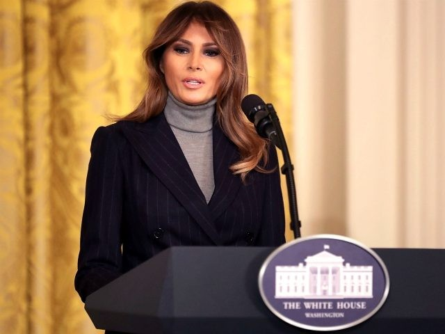 First lady Melania Trump (L) arrives in the East Room to deliver remarks during the White House Opioid Summit March 1, 2018 in Washington, DC. The summit was organized to focus attention on the national opioid addiction crisis and how to combat the epidemic. (Photo by Chip Somodevilla/Getty Images)