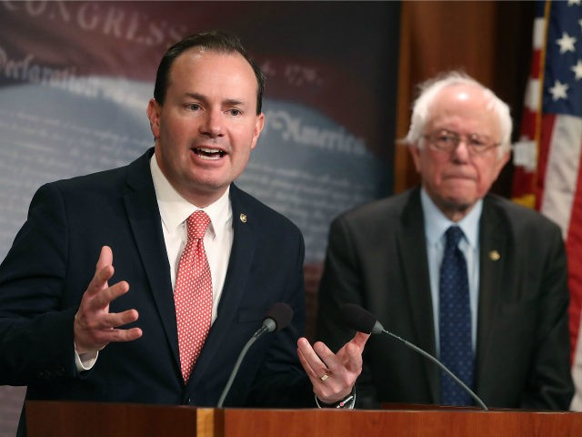 Sen. Mike Lee (R-UT), (L), and Sen. Bernie Sanders (I-VT), introduce a joint resolution to remove U.S. armed forces from hostilities between the Saudi-led coalition and the Houthis in Yemen, on Capitol Hill February 28, 2018 in Washington, DC. (Photo by Mark Wilson/Getty Images)
