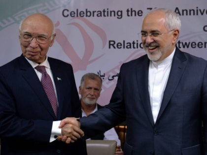 Iranian Foreign Minister Mohammad Javad Zarif (R) shakes hands with Deputy Chairman of Pakistan's Planning Commission Sartaj Aziz during an event at the Institute of Strategic Studies in Islamabad on March 12, 2018. Zarif is on an official visit to Pakistan. / AFP PHOTO / AAMIR QURESHI (Photo credit should …