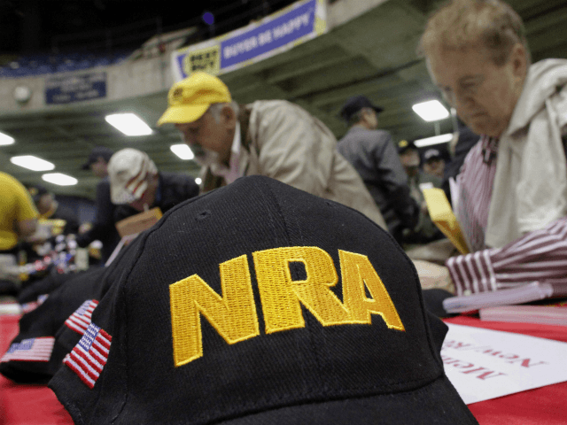 Illinois gun owners and supporters file out NRA applications while participating in an Illinois Gun Owners Lobby Day convention before marching to the Illinois State Capitol Wednesday, March 7, 2012 in Springfield, Ill. (AP Photo/Seth Perlman)