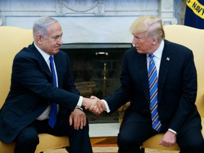 US President Donald Trump shakes hands with Israel's Prime Minister Benjamin Netanyahu in the Oval Office of the White House on March 5, 2018 in Washington, DC. President Donald Trump said he 'may' attend the opening of a controversial new US embassy in Jerusalem, a fraught prospect designed to underscore …