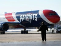 A member of the ground crew guides the team plane of the New England Patriots as it arrives for Super Bowl LII on January 29, 2018 at the Minneapolis-St. Paul International Airport in Minneapolis, MN.(Photo by Nick Wosika/Icon Sportswire via Getty Images)