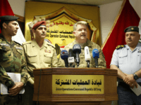 US Air Force Colonel John L. Dorrian (C), spokesman for Combined Joint Task Force - Operation Inherent Resolve, the US-led coalition fighting the Islamic State (IS) group in Iraq and Syria, speaks during a press conference in the capital Baghdad on April 11, 2017, accompanied by Brigadier General Yahya Rasool …