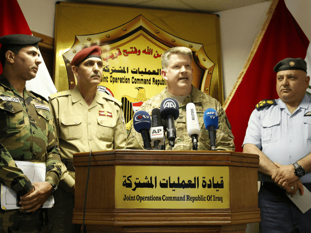 US Air Force Colonel John L. Dorrian (C), spokesman for Combined Joint Task Force - Operation Inherent Resolve, the US-led coalition fighting the Islamic State (IS) group in Iraq and Syria, speaks during a press conference in the capital Baghdad on April 11, 2017, accompanied by Brigadier General Yahya Rasool (L-2), spokesperson of the Iraqi Joint Operations Command coordinating anti-jihadist efforts, Brigadier General Saad Maan (L-1), spokesman for the Ministry of Interior and Baghdad operations, and Brigadier Tahseen Ibrahim (R), spokesman of the Ministry of Defense and Director of Media and Morale. IS now controls less than seven percent of Iraq, down from the 40 percent it held nearly three years ago, a military spokesman said on April 11, 2017. Iraqi forces backed by US-led air strikes and other support are now battling IS inside second city Mosul, after retaking much of the other territory the jihadists had seized. / AFP PHOTO / SABAH ARAR (Photo credit should read SABAH ARAR/AFP/Getty Images)