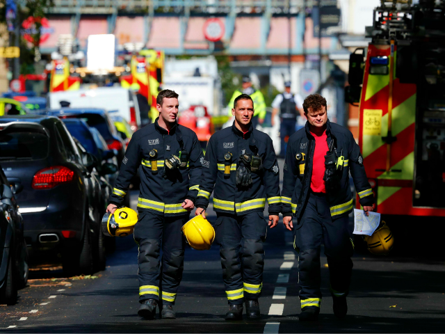 Members of the London Fire Brigade emergency service work near Parsons Green underground tube station in west London on September 15, 2017, following an incident on an underground tube carriage at the station. At least 22 people were injured after a bomb detonated on a packed London Underground train at …