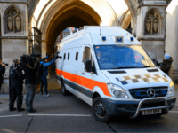 LONDON, ENGLAND - FEBRUARY 07: Members of the media look on as a prison van carries convicted rapist John Worboys from the High Court on February 7, 2018 in London, England. A judicial review hearing on March 13 will allow victims to challenge his planned release. (Photo by Leon Neal/Getty Images)