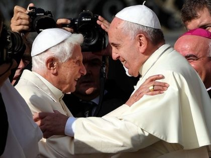 VATICAN CITY, VATICAN - SEPTEMBER 28: Pope Francis (R) greets Pope Emeritus Benedict XVI as he arrives at St. Peter's Basilica during a celebration for grandparents and the elderly on September 28, 2014 in Vatican City, Vatican. Pope Francis celebrated Mass on Sunday morning in St Peter's Square, following a …
