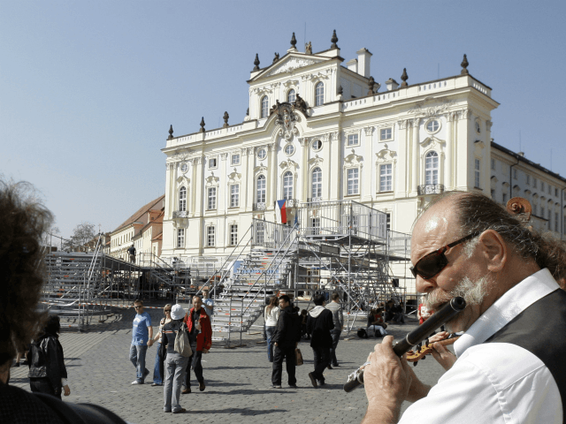 Street musicians play their instruments as tourist walk past the stage where US President Barack Obama will deliver his public speech on Sunday April 5, at the Hradcanske Square in Prague, Czech Republic on Friday, April 3, 2009. Obama will attend a summit between the United States and the 27-member …
