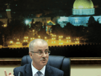 Palestinian Prime Minister, Rami Hamdallah talks during the first cabinet meeting of the new Palestinian unity government in the West Bank city of Ramallah on June 3, 2014. Under terms of the agreement, Hamas and Fatah, which dominates the West Bank administration, worked together to formulate an interim government of …