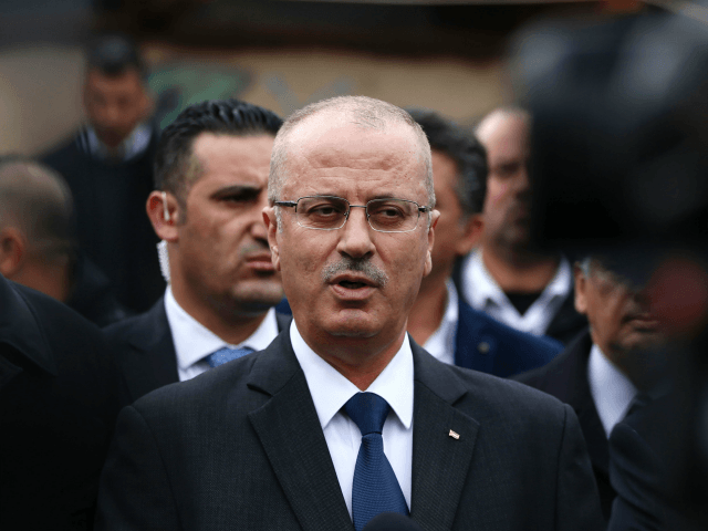 Palestinian prime minister Rami Hamdallah visits a primary school in the Palestinian Bedouin village of Khan al-Ahmar in the Israeli-occupied West Bank on March 2, 2017. The United Nations raised concerns last month over newly announced demolition plans in the Palestinian Bedouin village that threaten dozens of buildings including a primary school. / AFP PHOTO / ABBAS MOMANI (Photo credit should read ABBAS MOMANI/AFP/Getty Images)