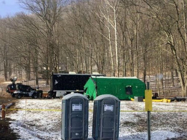 In this March 13, 2018 photo, FBI agents and representatives of the Pennsylvania Department of Conservation and Natural Resources set up a base off Route 555 in Benezette Township, Elk County, Pa., at a site where treasure hunters say Civil War-era gold is buried.