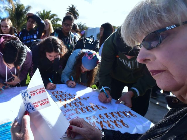 Students, at least 16 years old, register to vote on March 14, 2018, as students from Venice High School in Venice, California joined others in a nationwide walkout off campus for 17 minutes to protest gun violence and in honour to those who were killed a month ago. Students across …