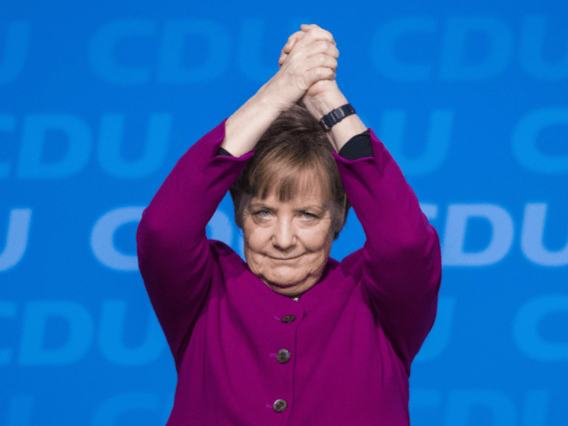 Merkel welcomes centre-left's OK for coalition
