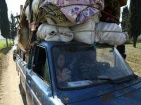 Syrian civilians fleeing Afrin on March 13, 2018. Photo: AFP / Nazeer al-Khatib