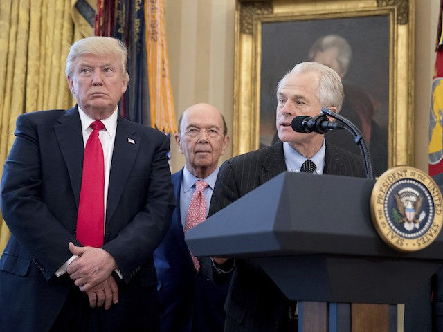 National Trade Council adviser Peter Navarro, second from right, accompanied by from left, President Donald Trump, Secretary of Commerce Wilbur Ross, and Vice President Mike Pence, speaks during a signing ceremony for executive orders regarding trade in the Oval Office at the White House, Friday, March 31, 2017, in Washington. …