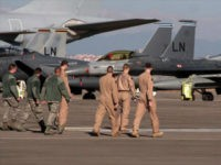 U. S. Air Force airmen walk toward fighter jets after Defense Secretary Ash Carter visited the Incirlik Air Base near Adana, Turkey, Tuesday, Dec. 15, 2015. Carter said the U.S. wants Turkey to better control its border with Syria, which could help block the flow of foreign fighters to the …