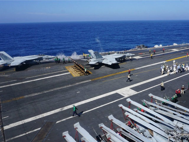 This general view shows the flight deck of the aircraft carrier USS Carl Vinson on February 14, 2018, as the carrier strike group takes part in a routine deployment mission in the South China Sea, one hour away from Manila. With a deafening roar and earthshaking vibrations, fighter jets zoomed off US carrier USS Carl Vinson as it navigated in the waters of the disputed South China Sea in what its admiral said February 14 was a tangible sign of American presence in the region. / AFP PHOTO / AYEE MACARAIG (Photo credit should read AYEE MACARAIG/AFP/Getty Images)