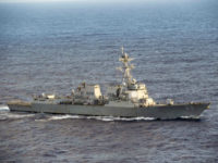 """The USS Mustin American destroyer sailed within 12 nautical miles of Mischief Reef in the Spratly Islands on Friday, prompting an angry statement from Beijing claiming that China has """"indisputable sovereignty"""" over the islands and accusing the United States of """"harming regional peace and stability"""" with its patrols."""