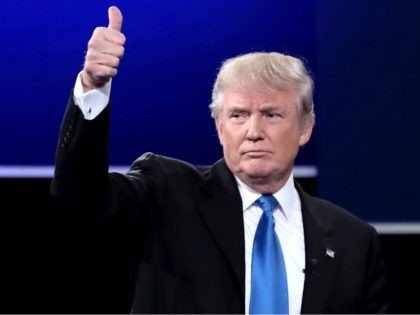 Republican presidential nominee Donald Trump waves after the Presidential Debate with Democratic presidential nominee Hillary Clinton at Hofstra University on September 26, 2016 in Hempstead, New York. The first of four debates for the 2016 Election, three Presidential and one Vice Presidential, is moderated by NBC's Lester Holt. (Photo by …