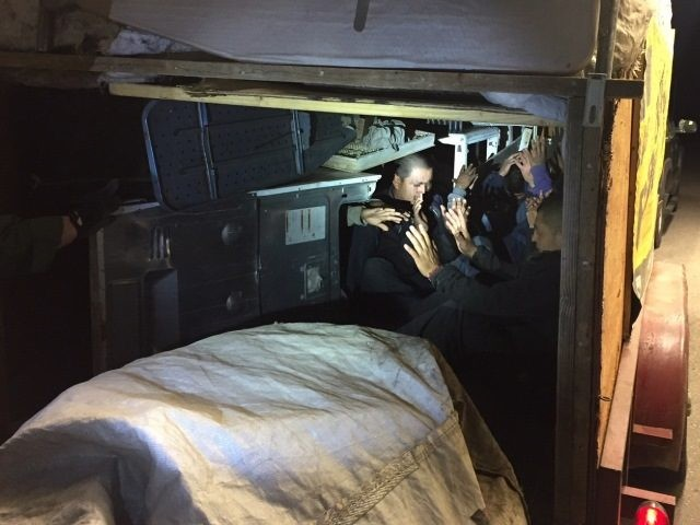 Border Patrol agents find 10 illegal aliens locked in trailer packed with cargo and appliances.
