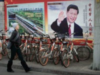 A propaganda poster showing China's President Xi Jinping is pictured on a wall in Beijing on March 12, 2018. China's Xi Jinping on March 11 secured a path to rule indefinitely as parliament abolished presidential term limits, handing him almost total authority to pursue a vision of transforming the nation …