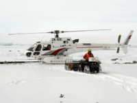 A group of U.S. climate scientists have had to be rescued by helicopter from Antarctica after being trapped by encroaching ice.