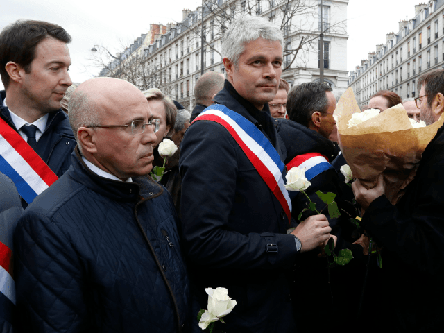 Politicians including LR MP Eric Ciotti (2L), LR president Laurent Wauquiez (C) and others prepare to take part in a slient march in Paris on March 28, 2018, in memory of Mireille Knoll, an 85-year-old Jewish woman murdered in her home in what police believe was an anti-Semitic attack. The …