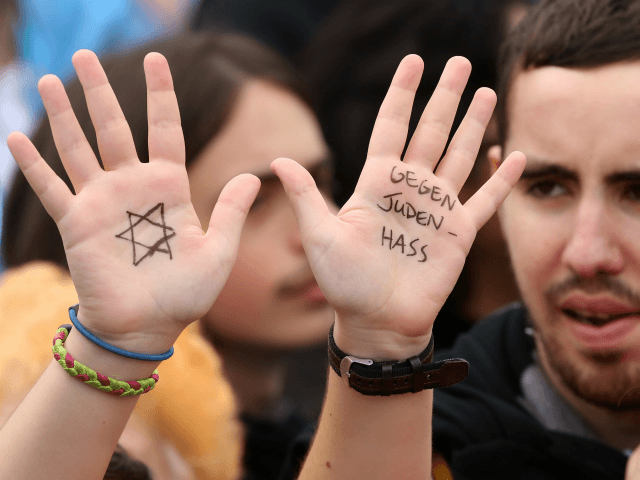 A visitor with with a Star of David and the words 'Against Hatred Toward Jews' written on her hands attends a rally against anti-Semitism on September 14, 2014 in Berlin, Germany. With the slogan 'Stand Up! Never Again Hatred Towards Jews' ('Steh auf! Nie wieder Judenhass'), the Central Council of …
