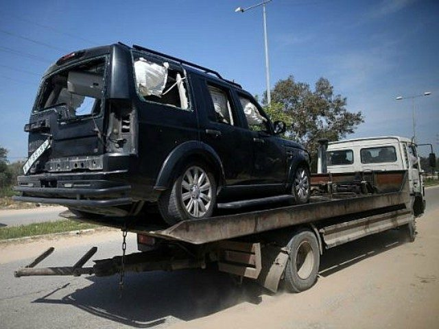 A vehicle damaged in the explosion that went off near Palestinian Authority Prime Minister Rami Hamdallah's convoy is seen in the northern Gaza city of Beit Hanoun on March 13, 2018. (AFP Photo/Mohammed Abed)