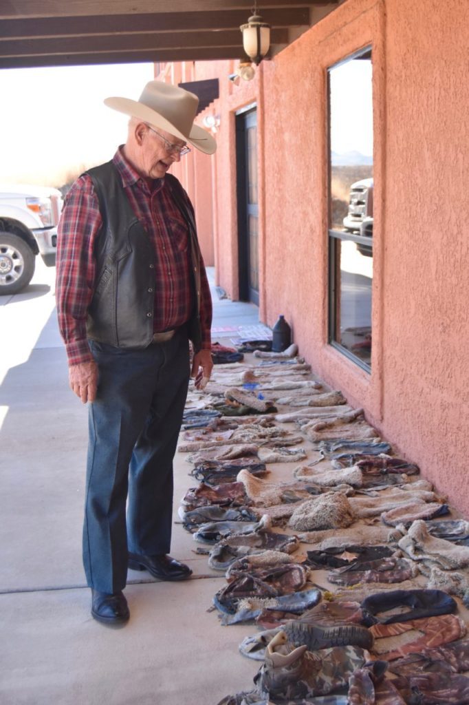 Arizona rancher Jim Chilton stands on the front porch of his home with dozens of 'carpet shoes' worn by illegal aliens entering the United States. Chilton said the carpet on the bottom of the shoes makes it harder for the U.S. Customs and Border Patrol agents to track people. (Penny Starr/Breitbart News)