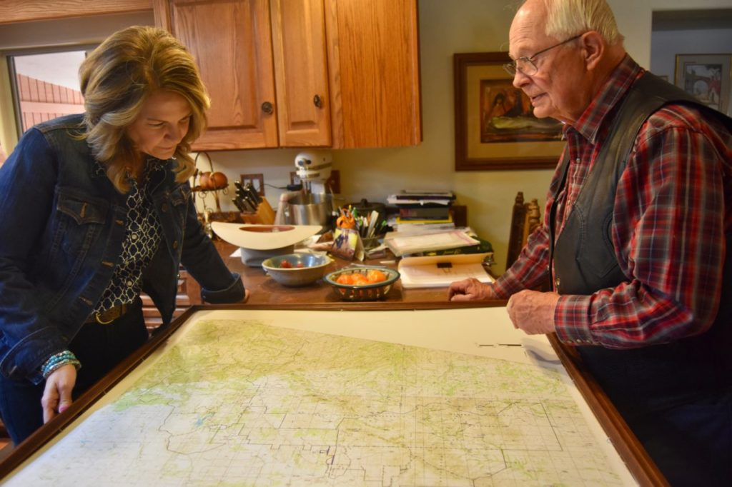 Arizona rancher Jim Chilton shows Kelli Ward, Republican candidate for the U.S. Senate in that state, a map that shows how his 50,000-acre ranch stretches along the U.S. border with Mexico. (Penny Starr/Breitbart News)