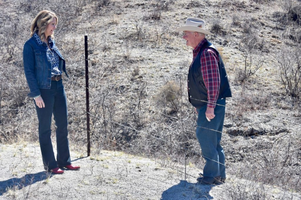 Republican U.S. Senate Candidate for Arizona Kelli Ward stands by the small barbed wire fence that serves as the border between the U.S. and Mexico. Rancher Jim Chilton crawled under it and stood on Mexican soil. (Penny Starr/Breitbart News)