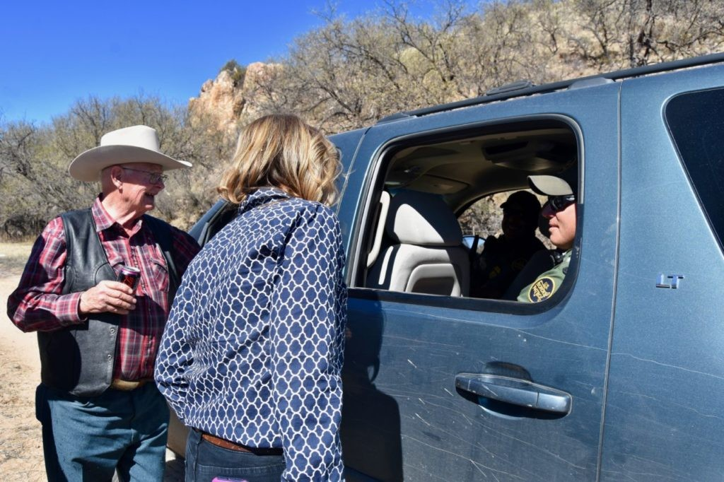 Republican U.S. Senate Candidate for Arizona Kelli Ward and Arizona rancher Jim Chilton talk to U.S. Customs and Border Protection agents who said they had been patrolling the border on foot. (Penny Starr/Breitbart News)