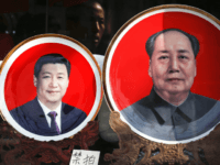 In this March 1, 2016 file photo, souvenir plates bearing images of Chinese President Xi Jinping, left, and late Chinese leader Mao Zedong are displayed at a shop near Tiananmen Square in Beijing. In 2016, the Chinese Communist Party bestows on Xi the wholly ceremonial yet highly significant title of …