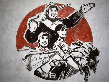 A Chinese revolutionary propaganda billboard in Zibo, a city in Shantung province of China on January 28, 1979 shows a gesturing worker, farmer and soldier. Billboards generally promote Communist Party's drive to make China a modern state by the year 2000. (AP Photo/Neal Ulevich)