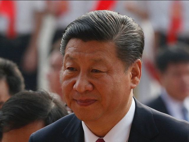 China's President Xi Jinping arrives for the inauguration ceremony of the Chinese sponsored Vietnam-China Cultural Friendship Palace in Hanoi on November 12, 2017. / AFP PHOTO / POOL / KHAM (Photo credit should read KHAM/AFP/Getty Images)