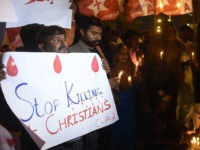 Pakistani Christians hold banners and lighted candles during a protest in Karachi on December 17, 2017, after a suicide bomber attack on a church in Quetta. At least eight people were killed and 15 wounded when two suicide bombers attacked a church in Pakistan during a service on December 17, just over a week before Christmas, police said. The attack took place at the Methodist Church in the restive southwestern city of Quetta in Balochistan province. / AFP PHOTO / RIZWAN TABASSUM (Photo credit should read RIZWAN TABASSUM/AFP/Getty Images)