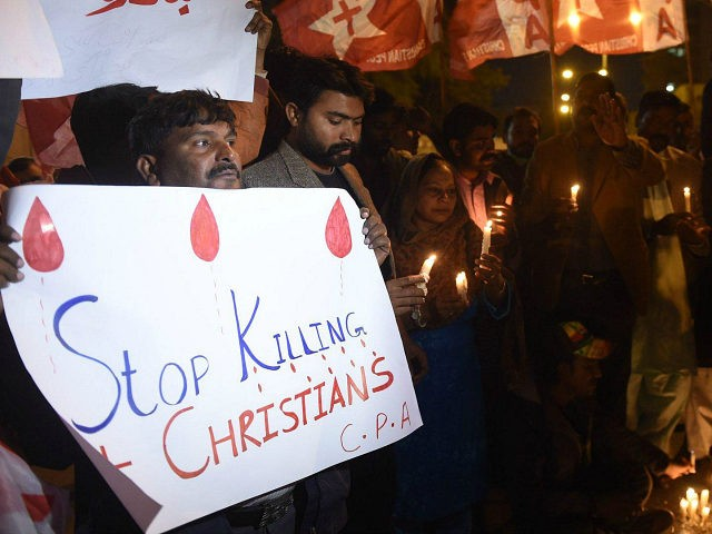 Pakistani Christians hold banners and lighted candles during a protest in Karachi on December 17, 2017, after a suicide bomber attack on a church in Quetta. At least eight people were killed and 15 wounded when two suicide bombers attacked a church in Pakistan during a service on December 17, …