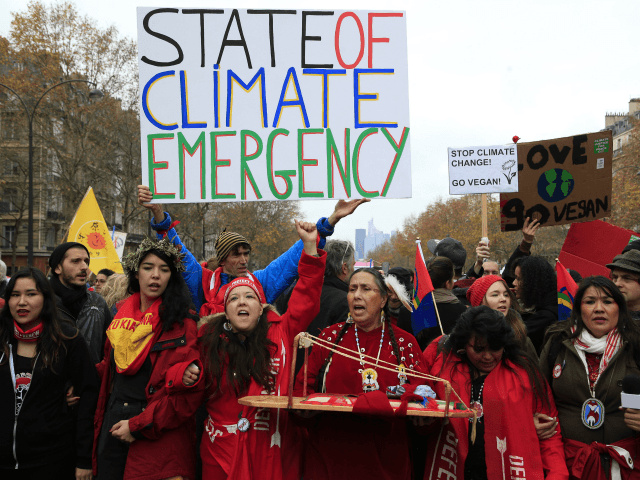 Climate activists demonstrate in Paris, Saturday, Dec.12, 2015 during the COP21, the United Nations Climate Change Conference. Several environmental and human rights groups are planning protests around Paris to call attention to populations threatened by man-made global warming and urge an end to human use of oil, gas and coal. …