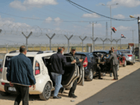 Palestinian Authority officials are seen at the northern entrance of the Gaza Strip just after the Israeli-controlled Erez crossing, on November 1, 2017 in Beit Hanun. Hamas handed over control of the Gaza Strip's borders with Egypt and Israel to the Palestinian Authority in the first key test of a …