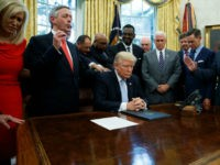 Faith leaders pray with President Donald Trump after he signed a proclamation for a national day of prayer to occur on Sunday, Sept. 3, 2017, in the Oval Office of the White House, Friday, Sept. 1, 2017, in Washington. (AP Photo/Evan Vucci)