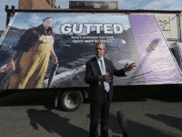 GRIMSBY, UNITED KINGDOM - APRIL 08: United Kingdom Independence Party (UKIP) leader Nigel Farage unveils UKIP's latest campaign poster in support of the fishing industry during campaigning on April 8, 2015 in Grimsby, United Kingdom. During his vist to the northern fishing port Farage announced in Grimsby that a system …