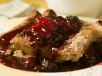 Oven-baked French Toast with Mixed Berry Sauce is seen in this Monday, Feb. 2, 2009 photo. Breakfast is a meal that is easy and inexpensive to turn into a special event. This dish can be tailored to use whatever your favorite berry is. (AP Photo/Larry Crowe)
