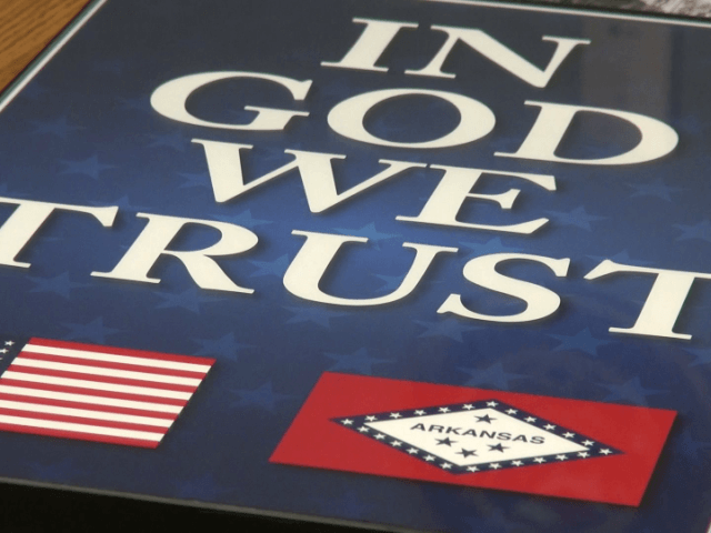 "The school districts of Bentonville and Pea Ridge will soon have ""In God We Trust"" posters displayed in classrooms after the implementation of a new law."