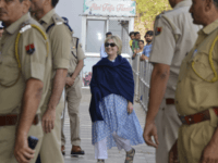 In this Thursday, March 15, 2018 photo, former U.S. Secretary of State Hillary Clinton, center, arrives at the departure terminal of Jodhpur airport in Rajasthan state, India. (AP Photo/Sunil Verma)