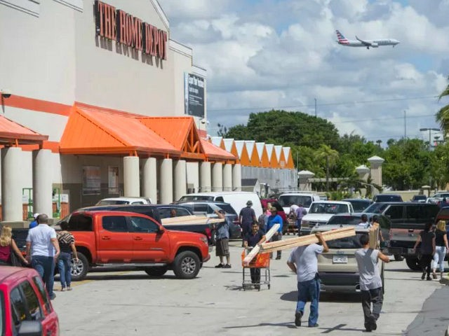 People leave with supplies outside a Home Depot store in Miami, Florida, as they prepare for Hurricane Irma, September 7, 2017. Miami orders people living in popular beach areas to evacuate as Hurricane Irma closes in, amid fuel shortages and traffic bottlenecks that threaten to complicate a mass exodus from the Sunshine State. / AFP PHOTO / SAUL LOEB (Photo credit should read SAUL LOEB/AFP/Getty Images)