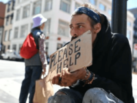Andrew Loy begs along a sidewalk in downtown San Francisco on June, 28, 2016. Homelessness is on the rise in the city, which has some of the highest housing costs in the nation.