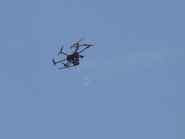 A drone used by Israeli troops fires teargas at Palestinians during a demonstration near the Gaza Strip border with Israel, in eastern Gaza City, Friday, March 30, 2018. Palestinians clashed with Israeli troops along the Gaza border Friday morning as thousands gathered there for mass sit-ins led by the militant …